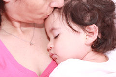 Woman with sleeping baby Royalty Free Stock Images