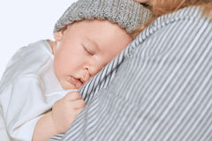Woman with sleeping baby isolated. Stock Photography