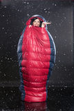 Woman In the Sleeping Bag. Young woman with the down sleeping bag royalty free stock photos