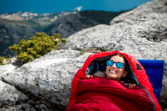 Woman in sleeping bag on the mountain Stock Photos