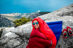 Woman in sleeping bag on the mountain Stock Photo