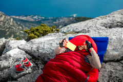 Woman in sleeping bag on the mountain Royalty Free Stock Photography