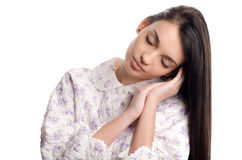 Woman sleeping. Beautiful girl in pajamas falling asleep. Stock Photos