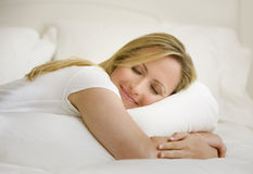 Woman Sleeping in Bed Stock Photos