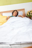 Woman Sleeping in Bed Royalty Free Stock Image