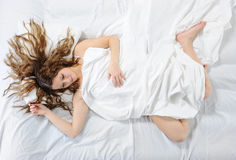 Woman sleeping on the bed Royalty Free Stock Photo