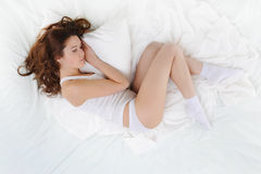 Woman sleeping on the bed Royalty Free Stock Image