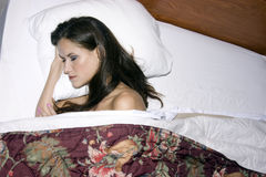 Woman sleeping hotel bed white sheets Royalty Free Stock Image