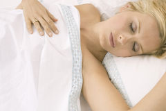Woman sleeping in bed. Royalty Free Stock Images