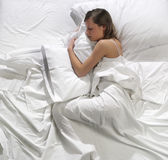 Woman sleeping in the bed Royalty Free Stock Photos