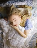 woman sleeping in bed royalty free stock photography