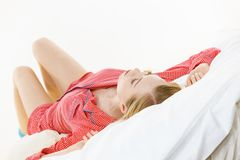 Woman sleeping in bed on back Stock Photos