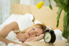 Woman sleeping in the bed Stock Images
