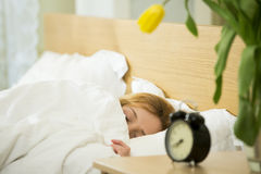 Woman sleeping in the bed Royalty Free Stock Photography
