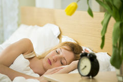 Woman sleeping in the bed Royalty Free Stock Image