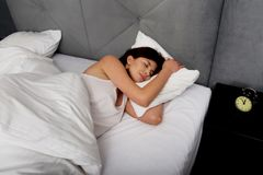 Woman sleeping in bed. Stock Photography