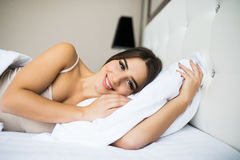 Woman sleeping in the bed. Beautiful young woman sleeping in the bed Royalty Free Stock Photography