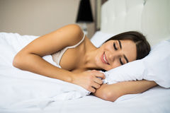 Woman sleeping in the bed. Beautiful young woman sleeping in the bed Stock Image