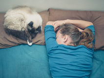Woman sleeping in bed with cat Royalty Free Stock Photos