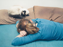 Woman sleeping in bed with cat Stock Photography