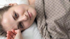 Woman sleeping in bed stock video footage