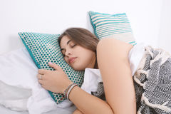 Woman sleeping on bed. Royalty Free Stock Images