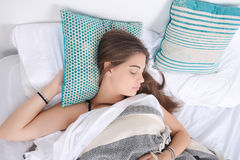Woman sleeping on bed. Royalty Free Stock Photography