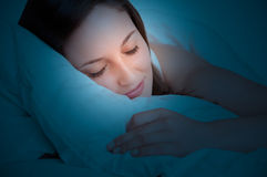 Woman Sleeping. In a bed in the dark stock photo