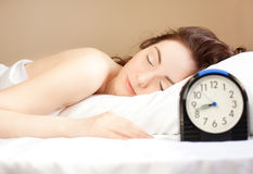 Woman sleeping in bed (focus on woman) Royalty Free Stock Images