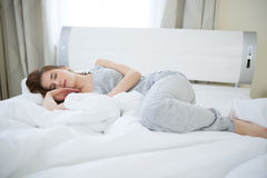 Woman sleeping on the bed at home Stock Photos