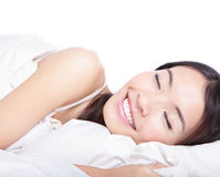Woman sleeping on the bed in the morning Stock Images