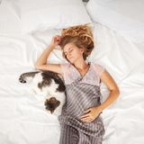 Woman sleeping in bed at the morning Royalty Free Stock Photography