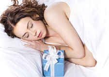 woman sleeping on the bed with presents Stock Images