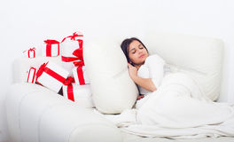Woman sleeping on the bed with presents Stock Photography