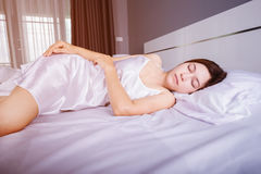 Woman sleeping on bed with soft light. Woman sleeping on bed in bedroom with soft light Stock Photos