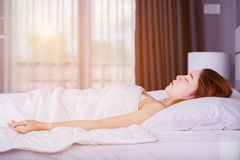 Woman sleeping on bed with soft light. Woman sleeping on bed in bedroom with soft light Royalty Free Stock Photography