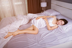 Woman sleeping on bed with soft light. Woman sleeping on bed in bedroom with soft light Royalty Free Stock Photos