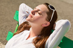 A woman is sleeping on the bench Stock Photos