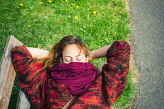 Woman sleeping on a bench in the park Royalty Free Stock Photo