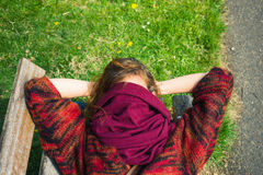 Woman sleeping on a bench in the park Stock Images