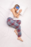 Woman sleeping with a blue eye mask Stock Images