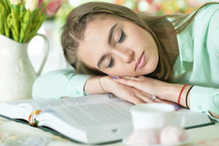 Woman sleeping on book Royalty Free Stock Images