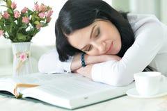 Woman sleeping on book Royalty Free Stock Photos