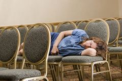 Woman sleeping at boring conference Royalty Free Stock Images