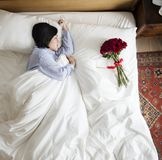 Woman sleeping and a bouquet of flower romance concept Stock Photos