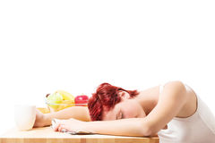 Woman sleeping at breakfast Royalty Free Stock Image