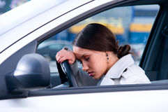 Woman is sleeping in a car Stock Image
