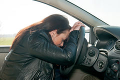 Woman sleeping in the car Royalty Free Stock Image