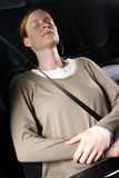 Woman Sleeping in a Car Stock Image