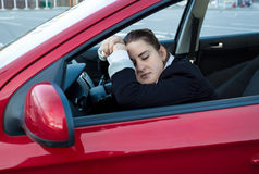 Woman sleeping in car on drivers seat Royalty Free Stock Images